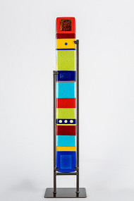"""Medium Standing Totem in Spectrum by Hands On Art Glass. 4""""x30"""", fused glass in a grey metal stand. Please call our galleries to see which pieces are currently on hand."""