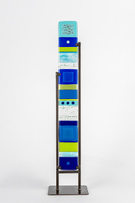 """Medium Standing Totem in Water by Hands On Art Glass. 4""""x30"""", fused glass in a grey metal stand. Please call our galleries to see which pieces are currently on hand."""
