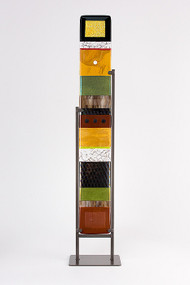 """Large Standing Totem in Earth by Hands On Art Glass. 5""""x36"""", fused glass in a grey metal stand. Please call our galleries to see which pieces are currently on hand."""