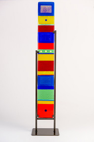 """Large Standing Totem in Spectrum by Hands On Art Glass. 5""""x36"""", fused glass in a grey metal stand. Please call our galleries to see which pieces are currently on hand."""