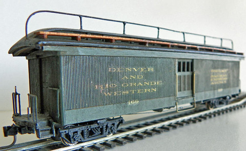 Built-up model (3168) with roof walk and railing added, painted, lettered, with trucks and  Kadee couplers.