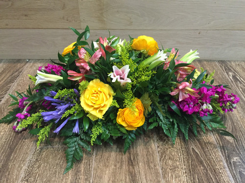 Cascades of color showcasing roses, lilies, stock, solidago, ranuculas, alstromeria and foliage in Washington DC and Rockville MD, Palace Florists