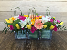 Cubes of Spring showcases 3 cubes filled with flowers such as roses, tulips, gerber daisies, lilies and more to fit together as one arrangement in Rockville MD and Washington DC, Palace Florists