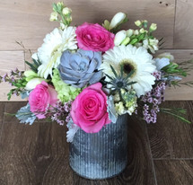 Rustic Spring with gerbers, tulips, freesia , hydrangea and succulent in rustic tin in Washington DC and Rockville MD, Palace Florists