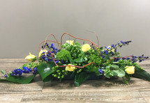 Through the Vines showcasing yellow roses, blue delphinium, green hypericum berries, green dianthis, curly willow and other foliage in Washington DC and Rockville MD, Palace Florists