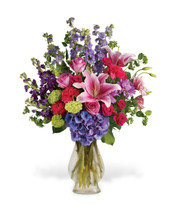 Beauty N' Bliss showcases fresh pink lilies, light purple dahlias, purple hydrangea and pink roses in a glass vase in Rockville MD and Washington DC, Palace Florists