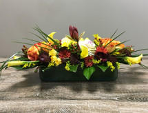 Fall Elegance Centerpiece showcases callas, kale, roses, amaryllis and other beautiful flowers in a leaf wrapped glass vase in Rockville MD, Palace Florists