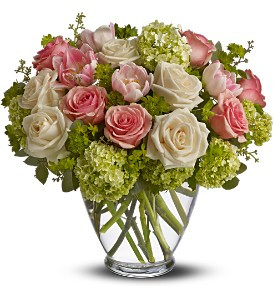 Spring Mist showcases roses, tulips and more, in shades of pink, crème and green hand-delivered in a glass vase in Rockville MD, Palace Florists