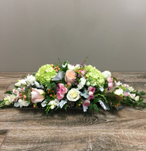 Perfect Pastels showcases pink roses, peach roses, lysianthis, hypericum berries and more with gorgeous foliage in this feminine centerpiece, Rockville MD, Palace Florists