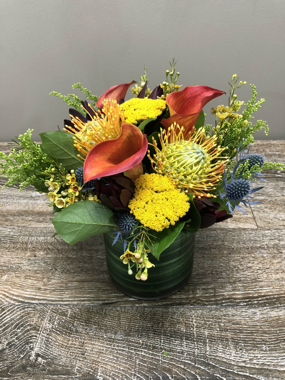 Cool nights rockville md palace florists cool nights showcases callas protea thistle and other beautiful flowers in a clear cylinder mightylinksfo
