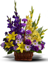 Basket of Memories showcases a vivid mix of purple and yellow blooms such as lilies, glads, carns and daisies in a in Washington DC and Rockville MD, Palace Florists