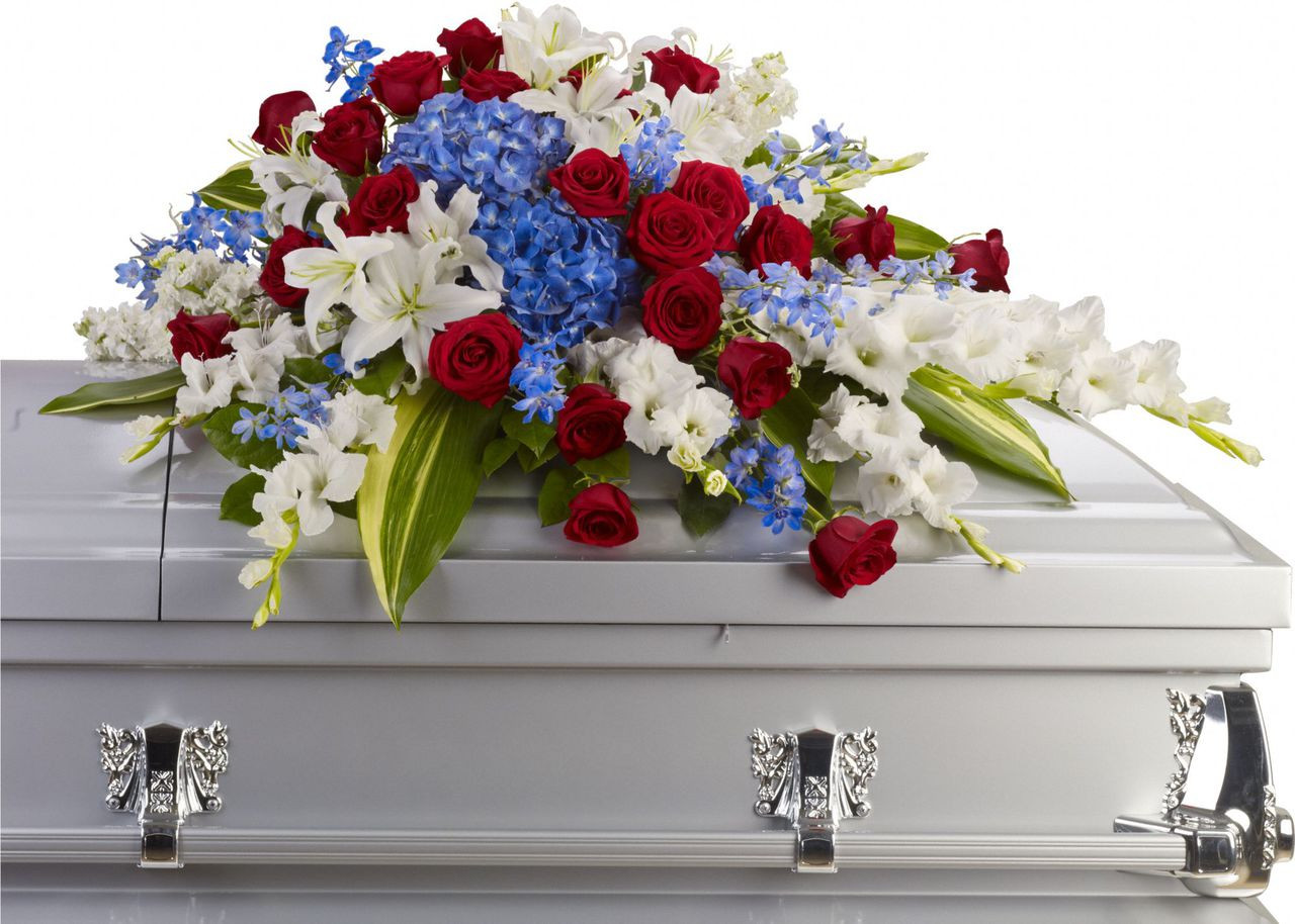 Rockville sympathy florist funeral flowers and wreaths palace distinguished service casket spray of brilliant flowers such as blue hydrangea red roses white izmirmasajfo