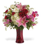 Kensington Gardens showcasing white hydrangea, stock, lisianthus, with pink oriental lilies, red roses, hot pink miniature carnations, seeded eucalyptus and more in a red vase in Rockville MD and Washington DC, Palace Florists