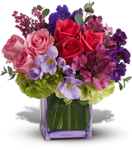 Exquisite Beauty  showcases green hydrangea, hot pink and light pink roses, purple alstroemeria, mini carnations, statice, lavender freesia, pink heather and eucalyptus in a glass cube in Washington DC and Rockville MD, Palace Florists