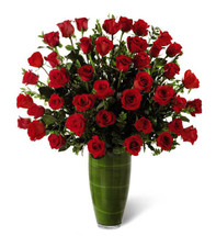 Three dozen royal roses with accent flowers and foliage in a clear vase in Washington DC and Rockville MD, Palace Florists