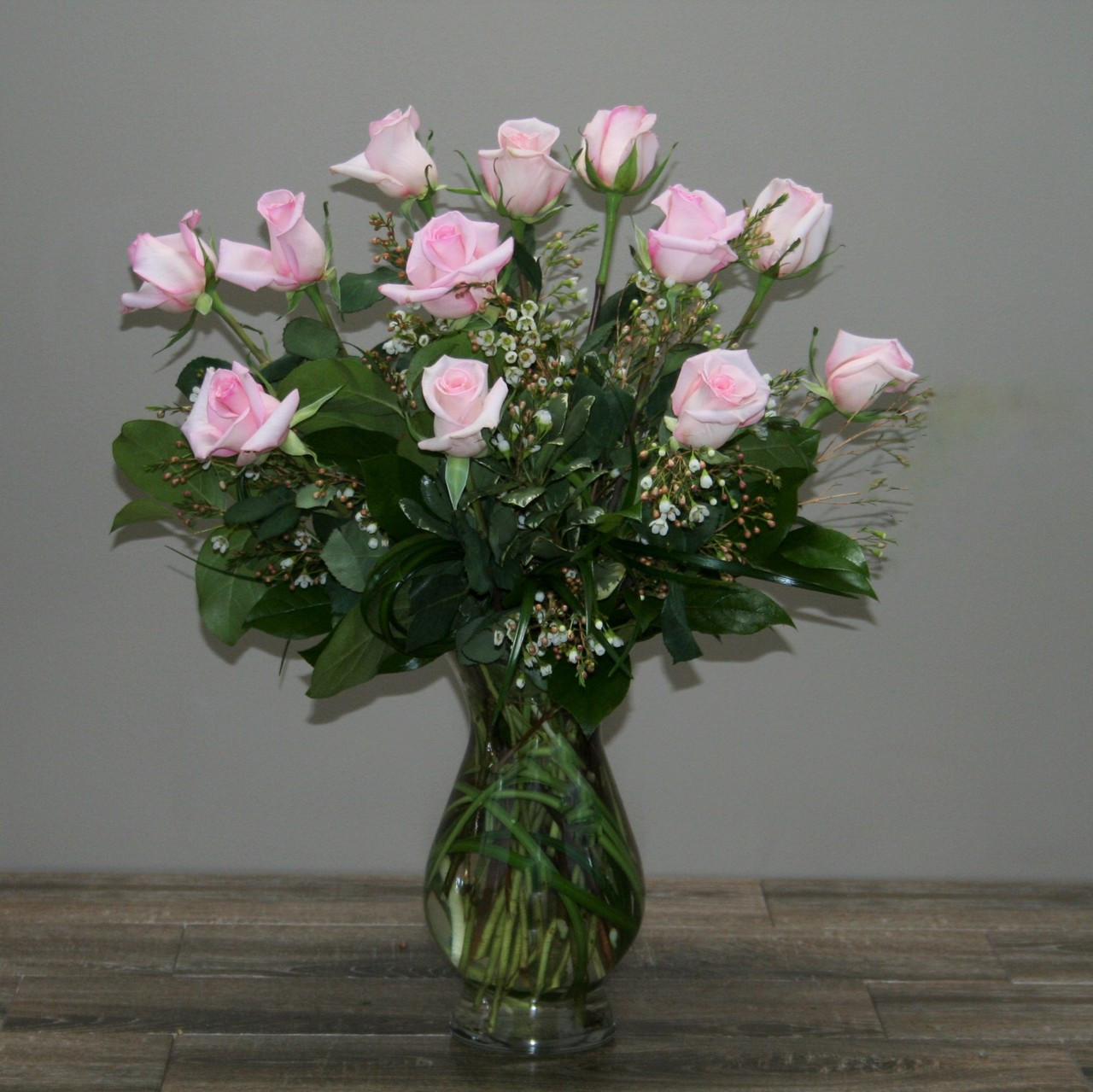Anniversary flowers gifts in rockville palace florists one dozen royal roses pink accented with wax flower coils of bear grass and beautiful dhlflorist Images