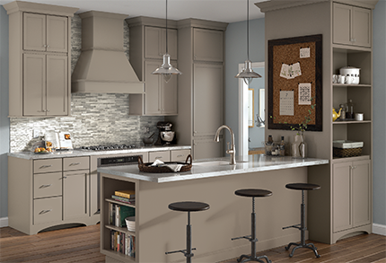 Galley Shaped Kitchen - KraftMaid Cabinetry on ceramic tile floors, galley living room, balcony floors, brown kitchen floors,