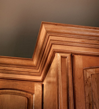 classic crown molding in honey spice cherry kraftmaid