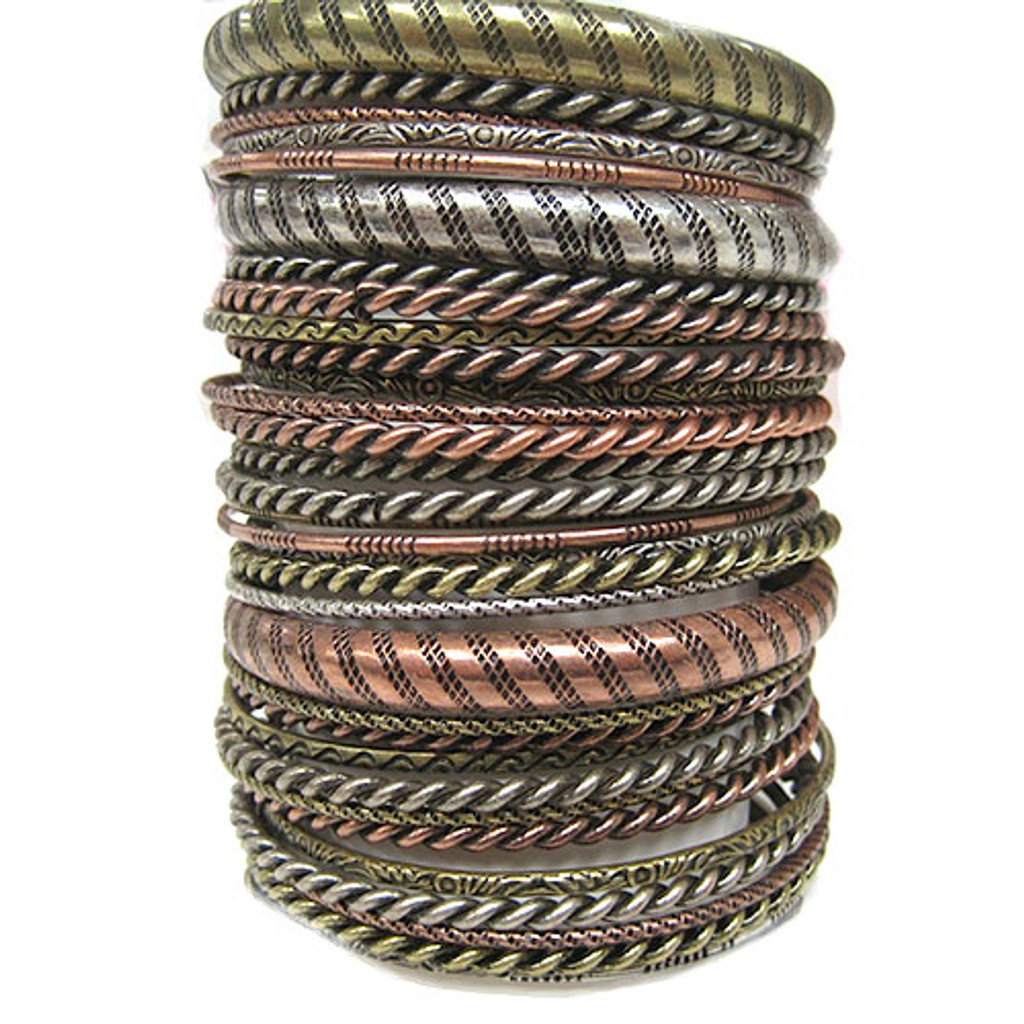 Thirty Five Antique Stackable Textured Bangles