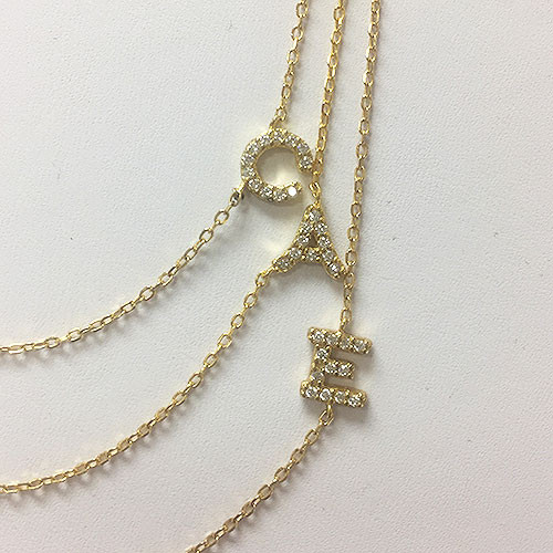 Cubic Zirconia Sideways Initials in Gold