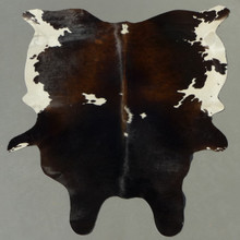 This large sized, dark reddish brown tricolor brindle cowhide is from Brazil and measures approximately 7x6 feet.  Rug may vary in design of color .... one of kind.   Brazilian cowhide rugs are world finest, distinguished by suppleness and quality.  Free Shipping
