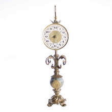 25H X 6W  Ornate table clock with pendulum Hand painted iron and brass in golden champagne and blue tones Quartz mechanism/AA Battery    Your Cost:  $372.00  MSRP: $465.00