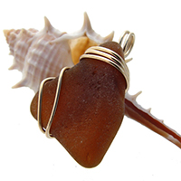 brown sea glass pendant in rold