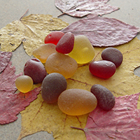 Red and gold sea glass pieces