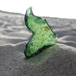 green glass shard that will become sea glass