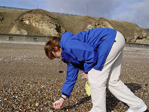 Linda on beach in Seaham England hunting sea glass
