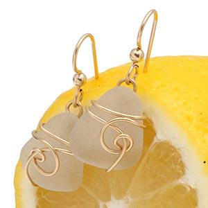 white sea glass earrings in gold