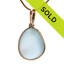 A nice perfect LARGE of vivid pale blue sea glass done in our Original Wire Bezel©2000 necklace pendant setting, it fully secures the glass while leaving both front and back open so you can reach up and feel this antique sea glass.