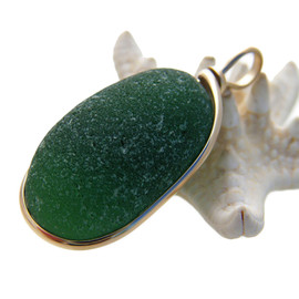 Great piece of natural sea glass in my Original Gold Wire Bezel© a simple design that lets all the beauty of this glass shine.  Top quality sea glass. A very large thick piece that alone measures 1 1/2 long by 3/4 inches wide and is a whopping 5/8 inches thick.