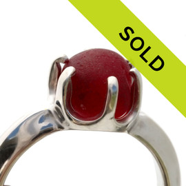 A stunning piece of vivid bright cherry red sea glass is set in a solid sterling hand cast ring base. The sea glass piece is TOTALLY UNALTERED from the way it was found on the beach. We sort through thousands of pieces of sea glass to find the right fit for our ring bases.