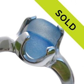A stunning piece of mixed aqua blue sea glass from England set in a solid sterling silver ring base. Sorry this ring has sold!