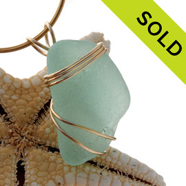 A beautiful thick top quality sea glass piece set in gold!