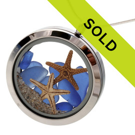 Beautiful blue sea glass combined with two real starfish and beach sand completes the scene! This locket has been sold