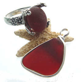 Custom ring and earrings made from our red sea glass. The earrings were made from Puerto Rican ruby sea glass and the ring was made from a piece of our English sea glass. (Note, the ring is NOT SET here, we were waiting on approval from our customer).