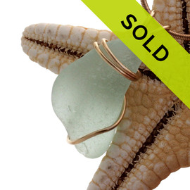 A perfect piece of seafoam green sea glass necklace pendant in a simple rolled gold setting.