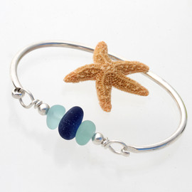 Dark blue and pale aqua sea glass from England set on a fully round solid sterling bangle bracelet.