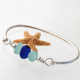 Vivid blue and pale aqua sea glass from England set on a fully round solid sterling bangle bracelet.