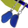 Vivid cobalt blue sea glass pieces set in our Original Wire Bezel© setting. This pair comes on quality sterling silver leverback ear wires.
