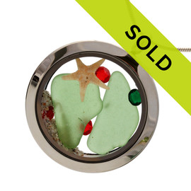 Green sea glass and vivid red gemstones make this a great locket necklace for the holidays. Sorry this locket has sold!