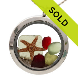 Olive green and ruby red sea glass with a starfish and beach sand in this holiday inspired sea glass locket necklace.