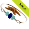 Thick and almost perfectly round vivid blue and vivid aqua blue sea glass pieces set on our best solid sterling silver bangle bracelet!
