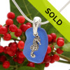 A top quality piece of cobalt blue beach found sea glass necklace combined with a sterling seahorse charm and on a professionally hand cast solid sterling bail.