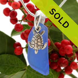 A good quality piece of cobalt blue beach found sea glass combined with a sterling sea turtle charm and on a professionally hand cast solid sterling bail.