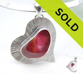 A unique piece of quality NATURAL mixed pink sea glass in a repeating heart shape. This piece is in a classic bezel setting of fine silver, professionally crafted by us.  The piece is fully backed and soldered for a lifetime of enjoyment. The silver backing lets light bounce back through the sea glass with another heart cut out of the back.  Heart shapes in sea glass are rare, specially in this amazing pink and gold sea glass from England. Multi sea glass is the byproduct of art glass companies that tossed their scrap glass into the North Sea.