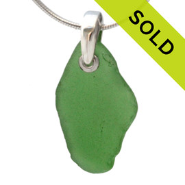 Beach found vivid green sea glass on a solid sterling professionally hand cast bail and presented on an 18 Inch solid sterling snake chain. Sorry this sea glass jewelry piece has been sold!