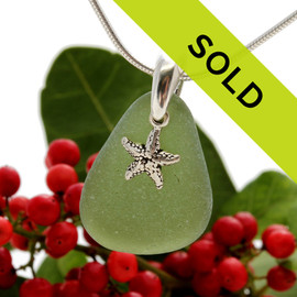 Beach found citron green sea glass is combined with a solid sterling starfish charm and presented on an 18 Inch solid sterling snake chain.